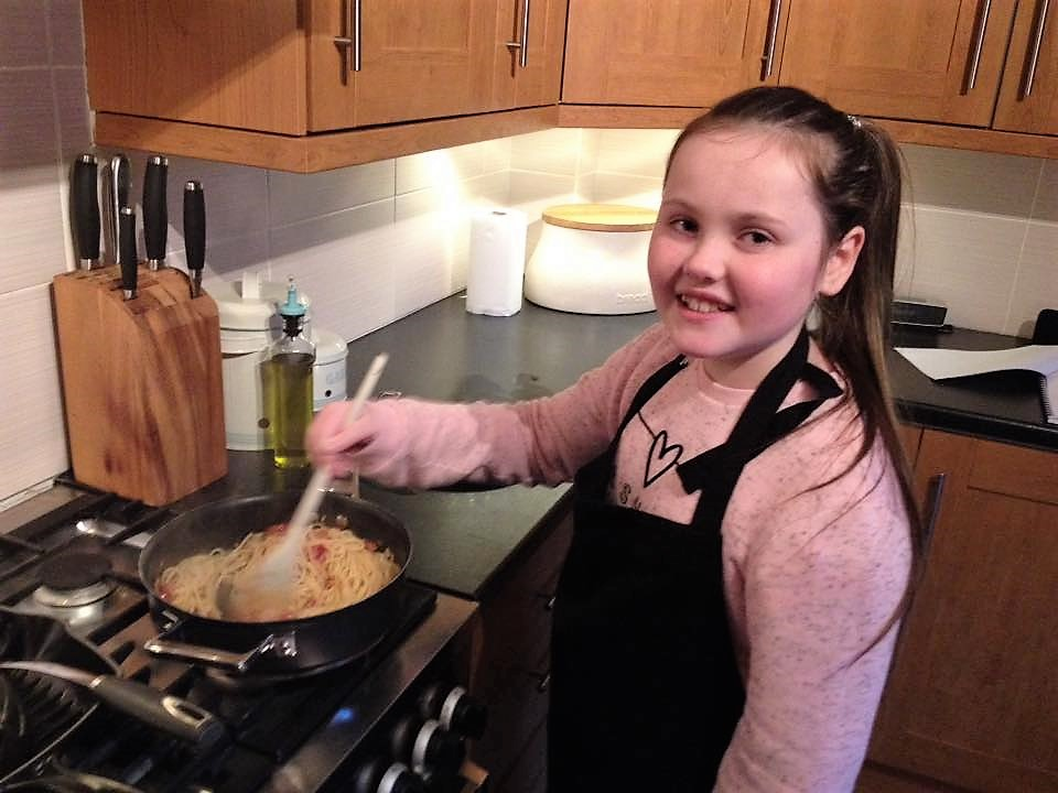 Young Client Cooking her Carbonara