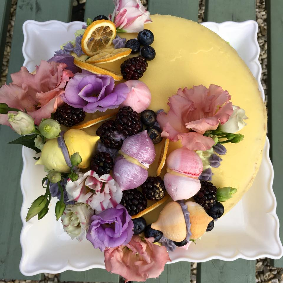 Home Made Lemon Sponge Sandwiched With Curd Frosted In Ercream And Decorated Dried Slices Mini Meringues Fresh Flowers